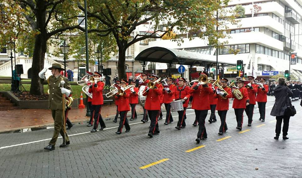 Photo of St Kilda Brass marching through Dunedin Octagon.
